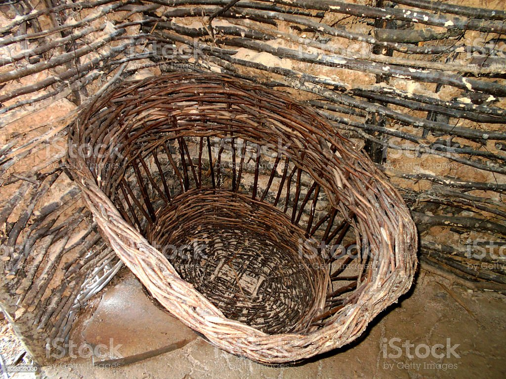 Large basket in the corner of the hut stock photo