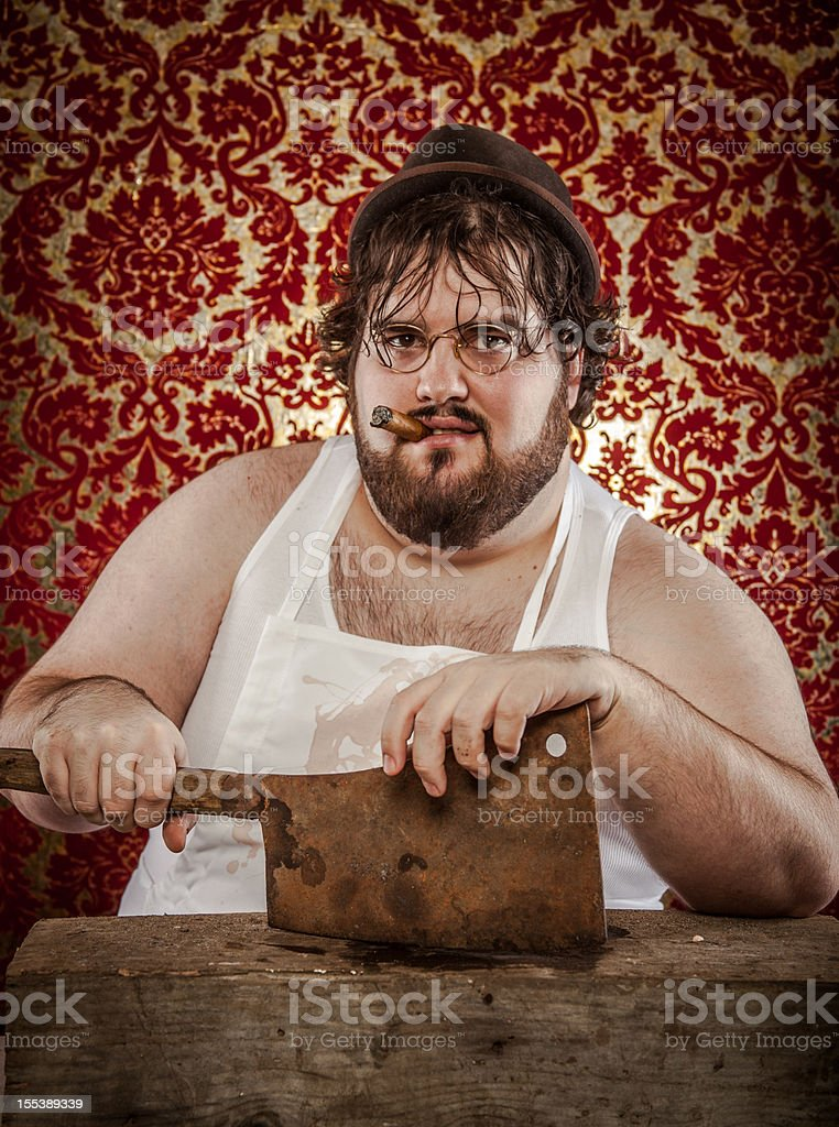Large Bearded Man Posing with Rusty Cleaver, Butcher's Block royalty-free stock photo