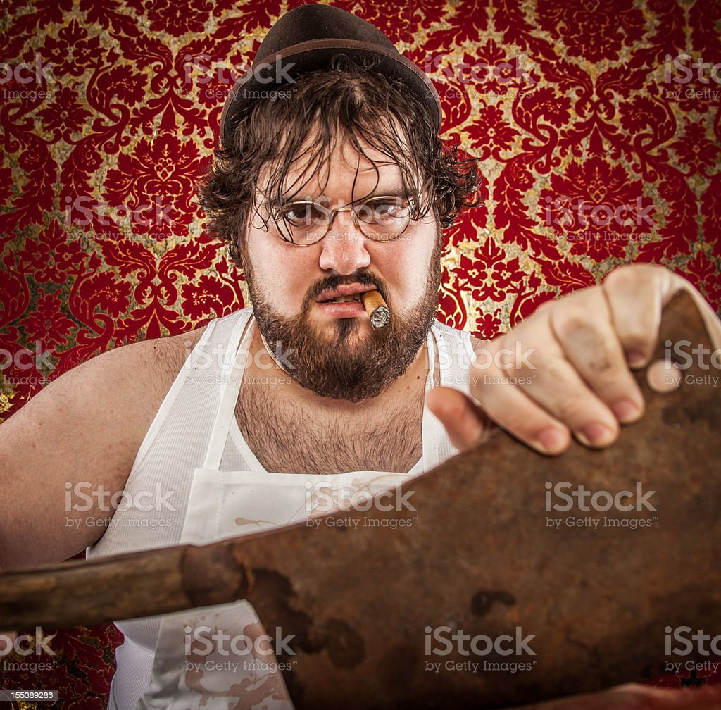 Large Bearded Man Posing with Rusty Cleaver, Closeup royalty-free stock photo
