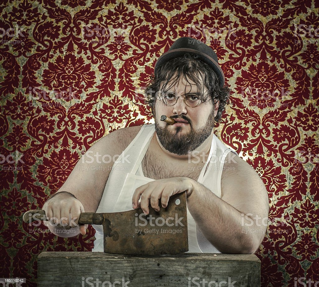 Large Bearded Man Posing with Rusty Cleaver, Wearing White Apron royalty-free stock photo