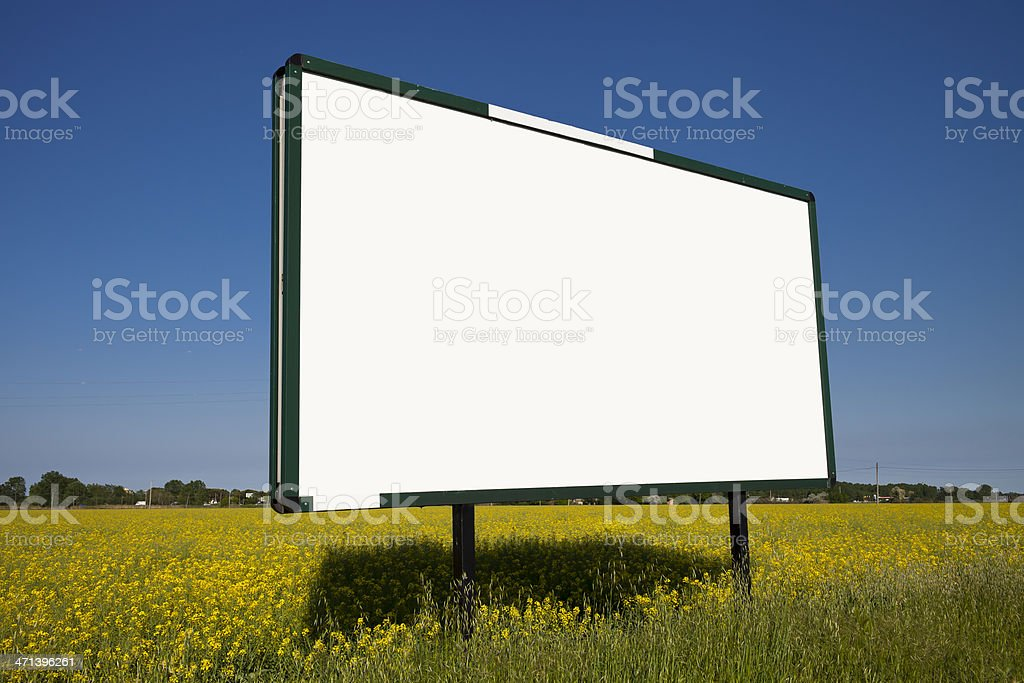 Large Billboard in a yellow field royalty-free stock photo