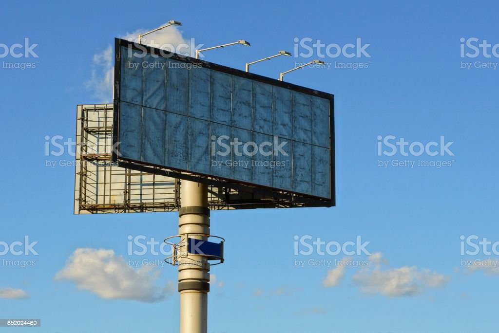 Large billboard on the pipe against the sky and clouds stock photo