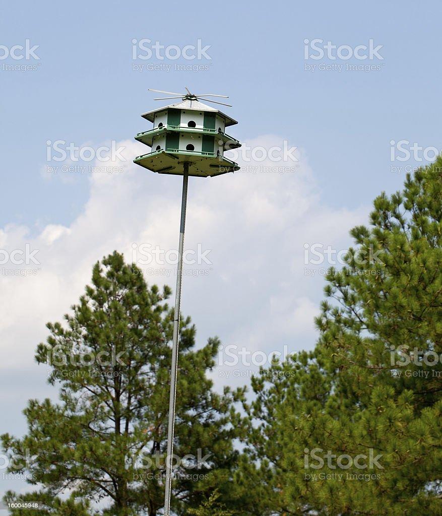 Large bird feeder on post royalty-free stock photo