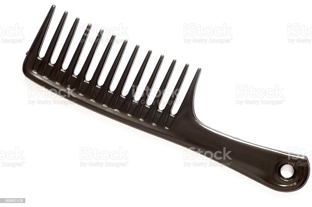 A large black comb on a white background stock photo
