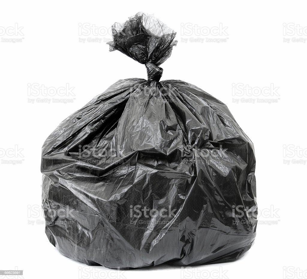 Large, black garage bag that is full and tied shut  royalty-free stock photo