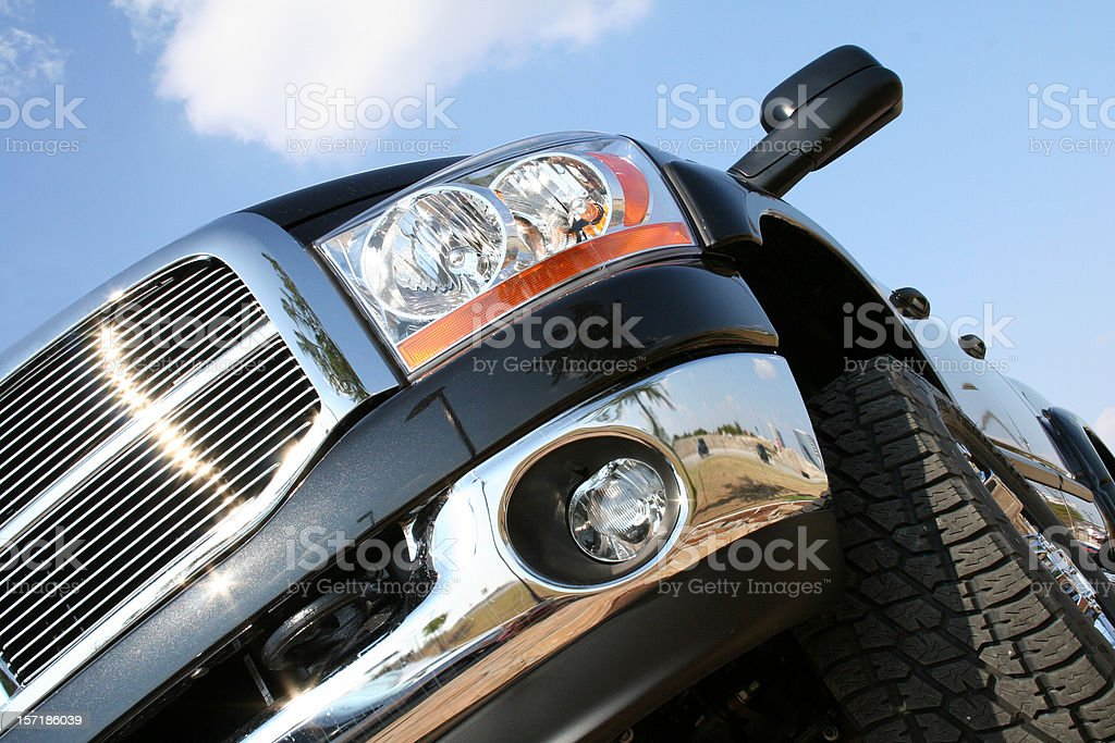 Large black truck with view of cloudscape stock photo