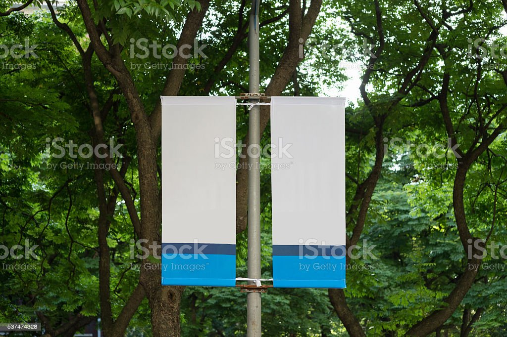 Large blank billboard on a street wall stock photo