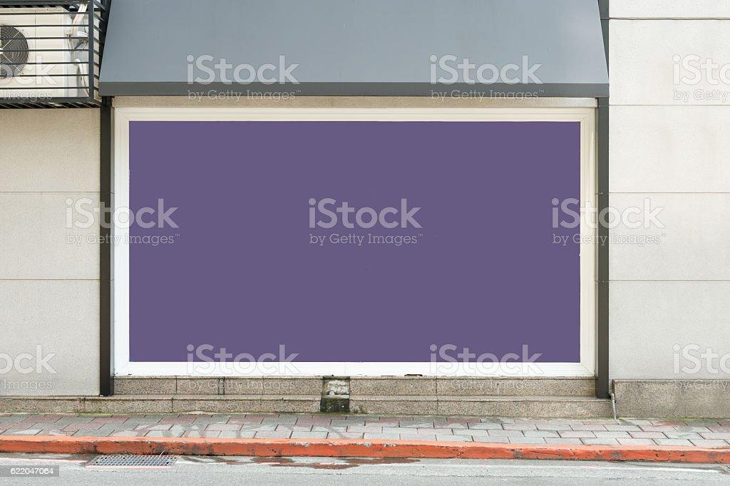 Large blank billboard on a street wall stock photo