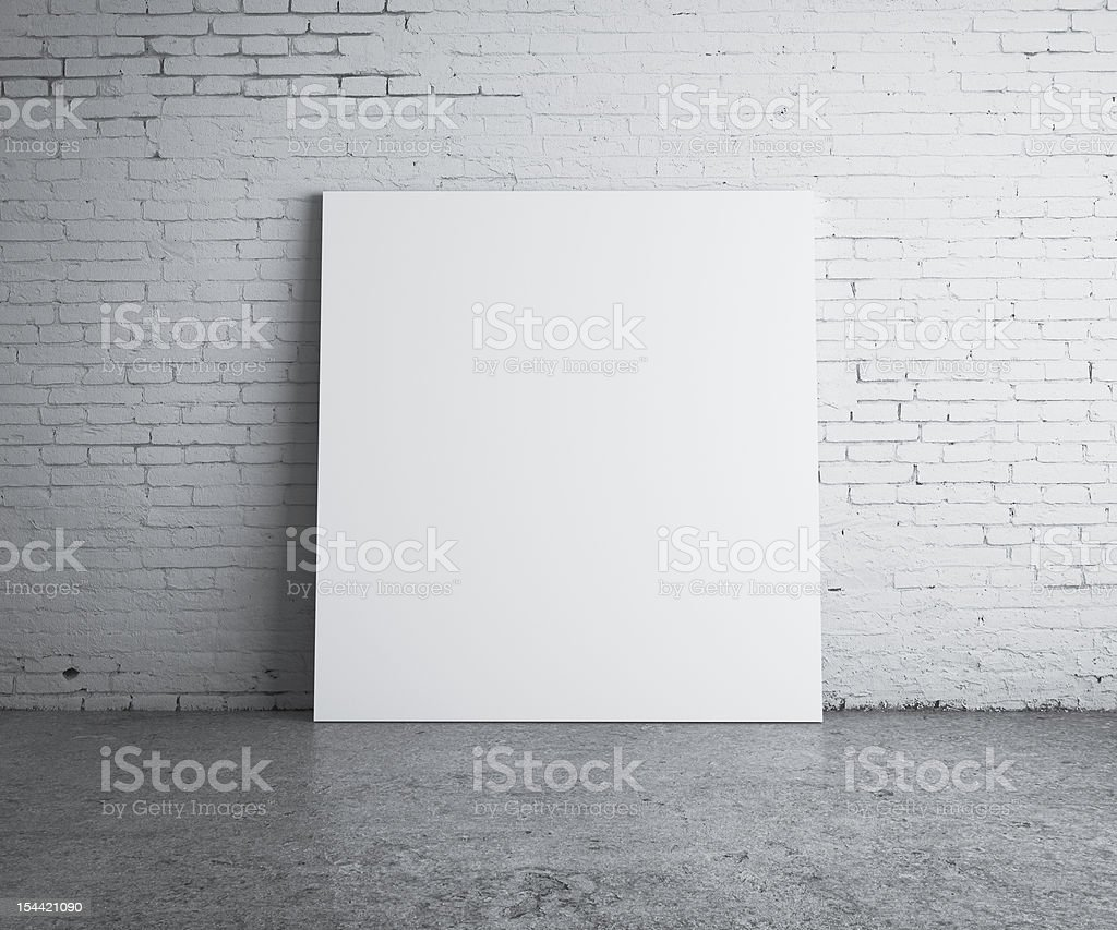 A large blank picture against a wall royalty-free stock photo