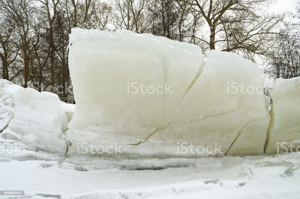 A large block of ice on the shore. stock photo