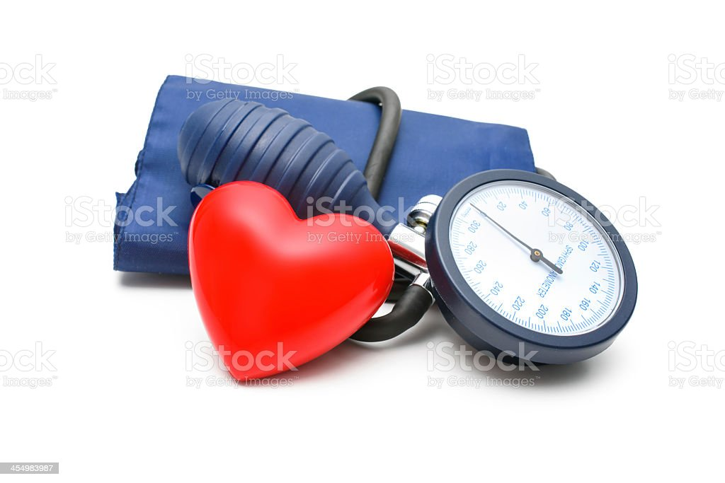 Large blood pressure gauge with a red heart leaning on it stock photo