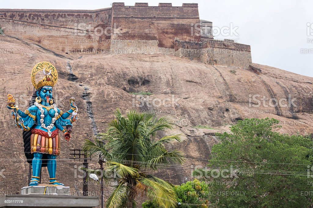 Large blue Kali statue at foot of Dindigul Rock Fort. stock photo