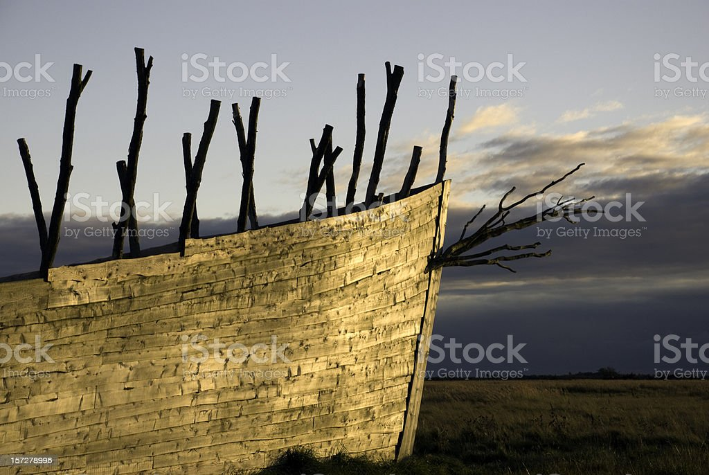 Large boat  on a field in the sunset stock photo