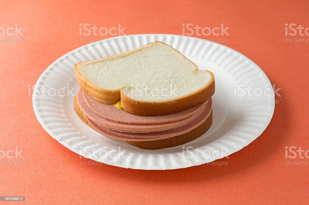Large bologna sandwich with mustard stock photo