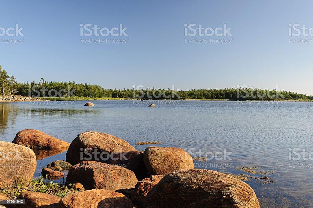 Large boulders on seashore, sunny summer day stock photo