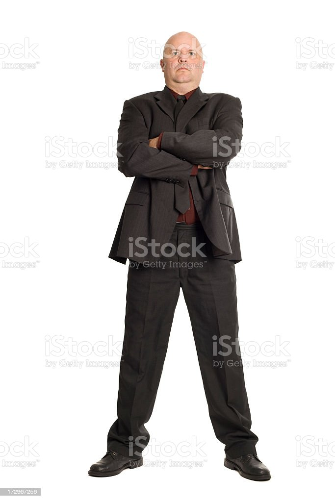 A large bouncer in a suit with his arms crossed stock photo