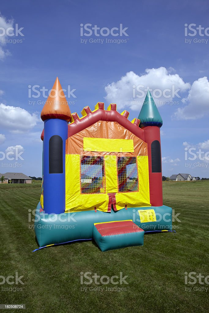 A large bouncy castle on a freshly mowed lawn stock photo