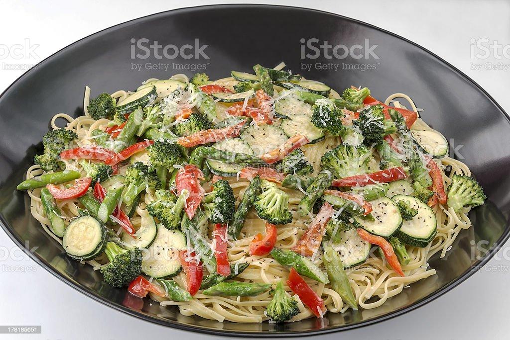Large bowl of pasta primavera on a white background stock photo