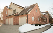 Large brick home with three stall attached garage