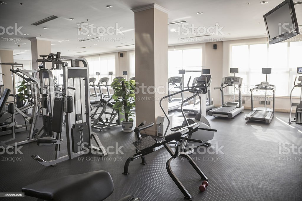 Large, bright gym with workout equipment. stock photo