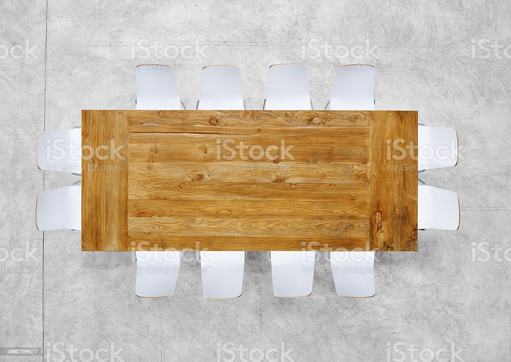 Large Brown Meeting Table with Twelve Chairs stock photo