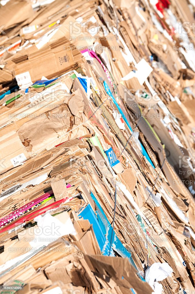 Large bundles of  cardboard and packing  material for recycling stock photo