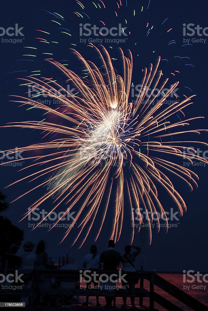 Large burst of fireworks over water royalty-free stock photo