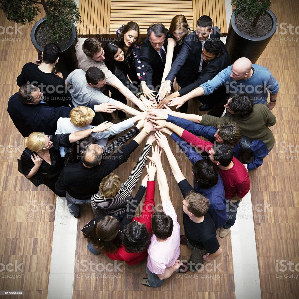 Large business team putting hands together royalty-free stock photo