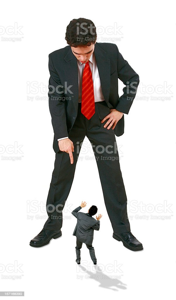 A large businessman towering over a small businessman royalty-free stock photo