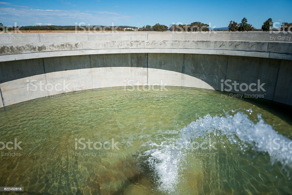 large calrifier tank being filled for the first time stock photo