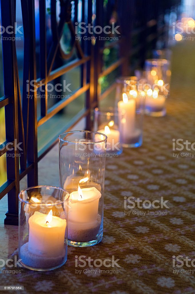 large candles in glass stock photo