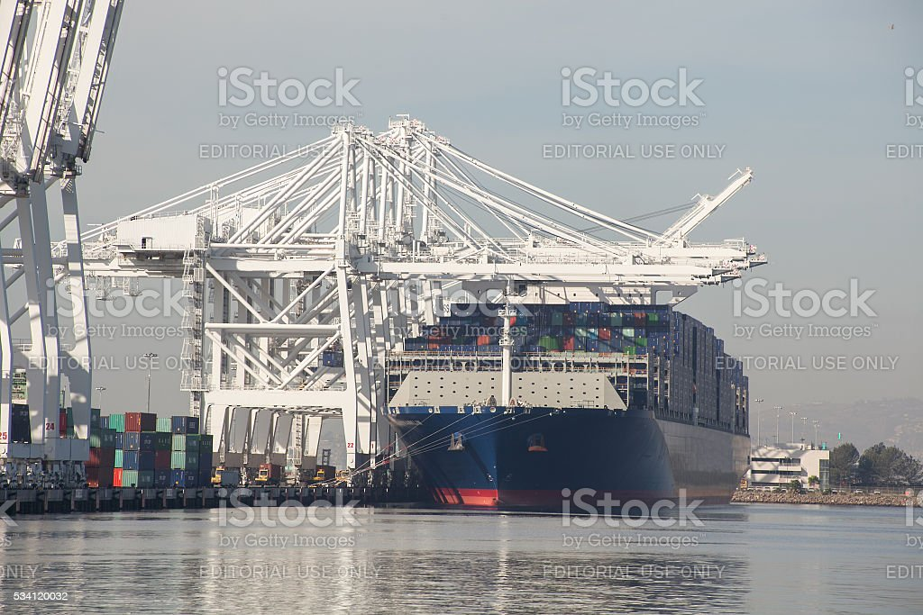 Large cargo container vessel docked Port of Los Angeles CA stock photo