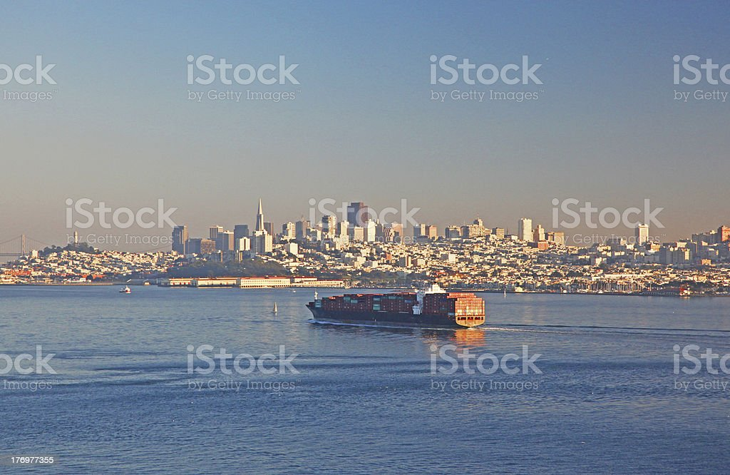 Large Cargo Ship Arrives in San Francisco Bay at Sunset royalty-free stock photo