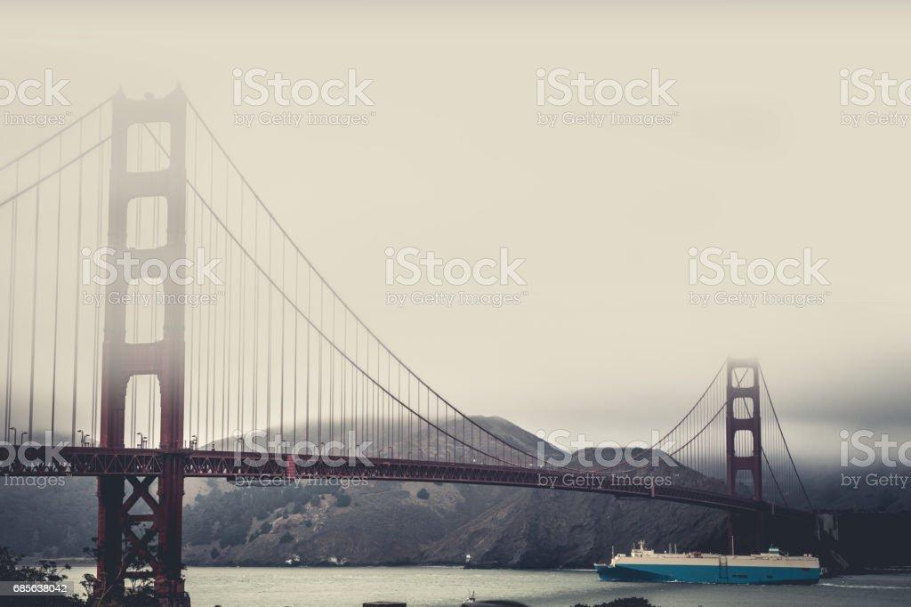 Large cargo ship passing on Golden Gate Bridge stock photo