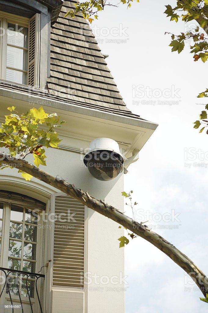 Large CCTV security surveillance camera on a NYC townhouse. royalty-free stock photo