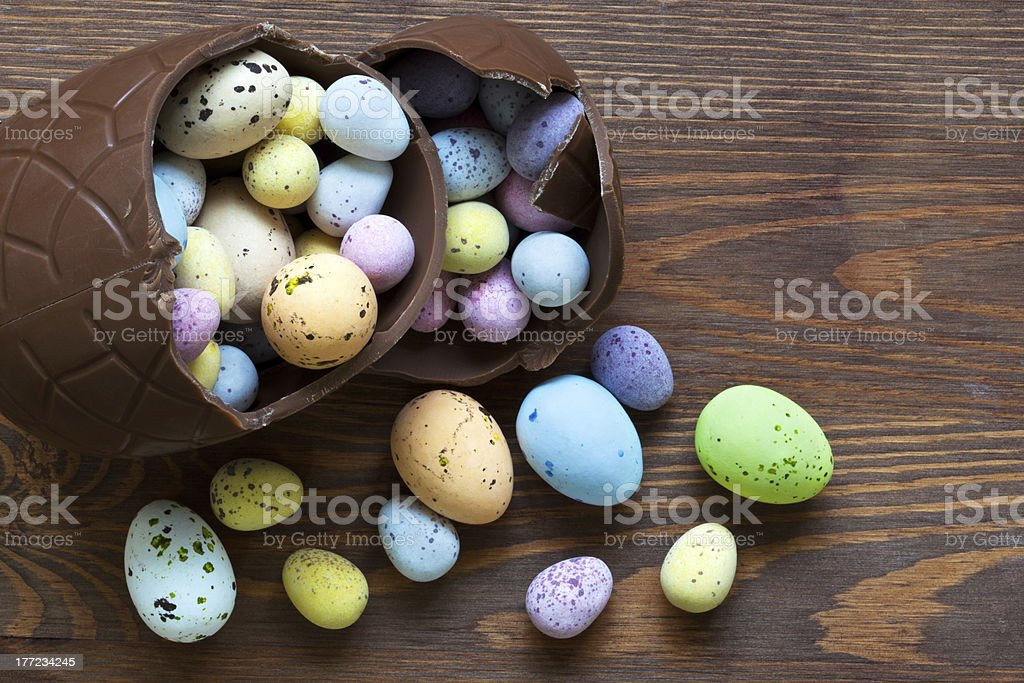 Large chocolate easter egg full of small candy stock photo