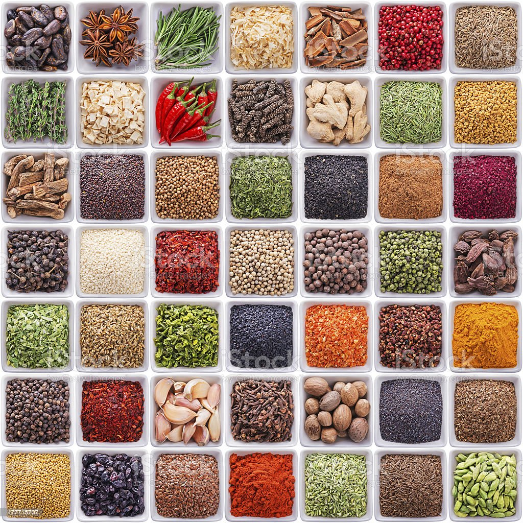 large collection of different spices and herbs royalty-free stock photo