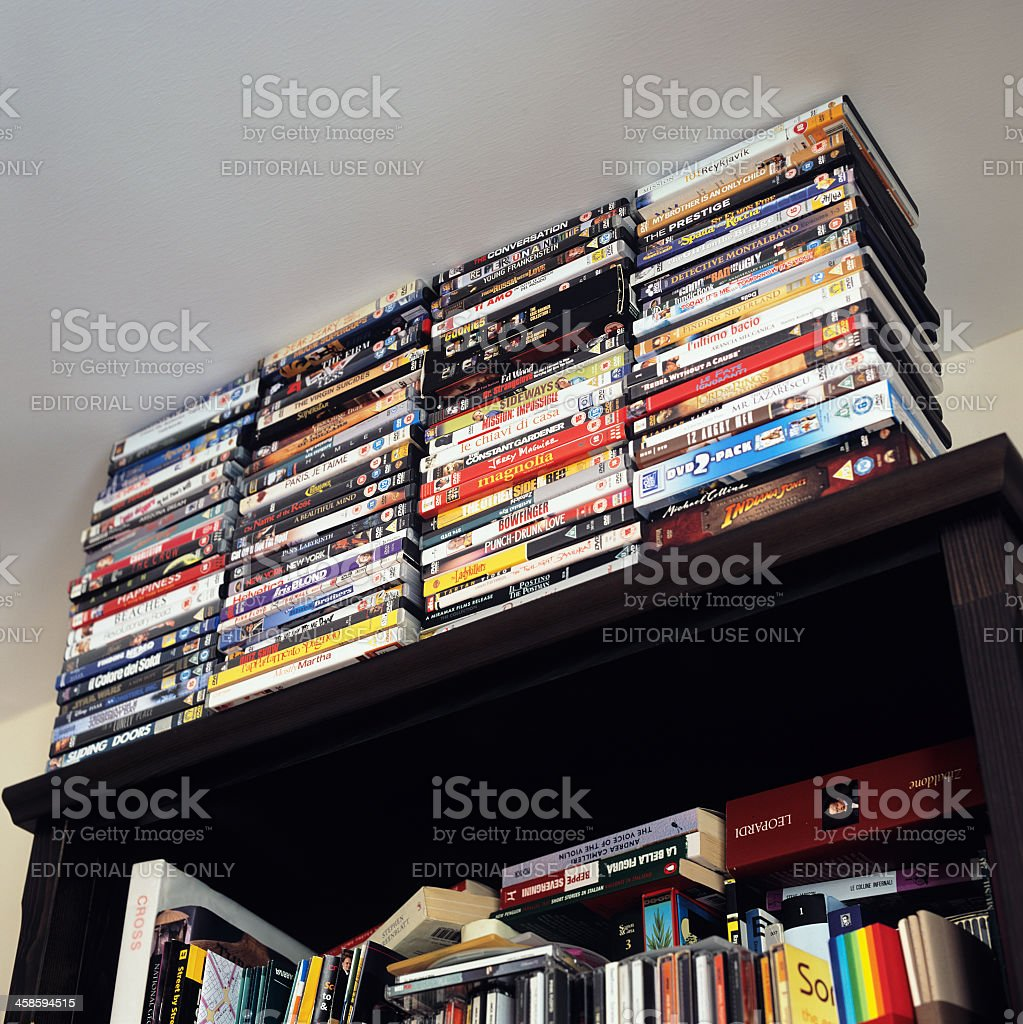 Large collection of DVDs on a domestic bookcase royalty-free stock photo