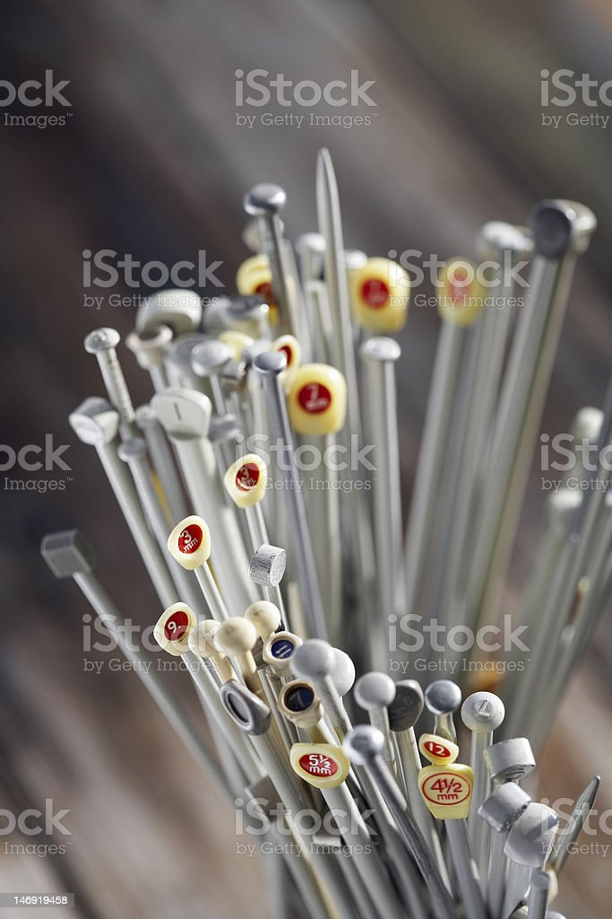 large collection of knitting needles stock photo