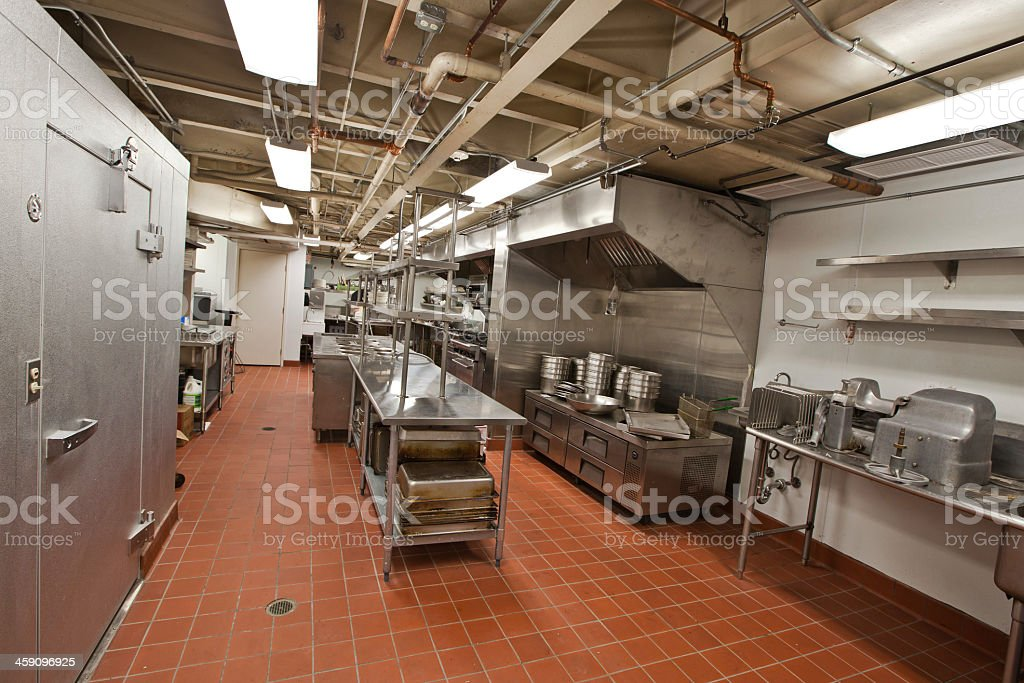 A large commercial kitchen in a restaurant stock photo