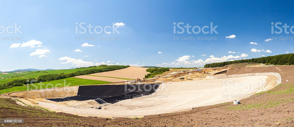 Large construction site surrounded by nature stock photo
