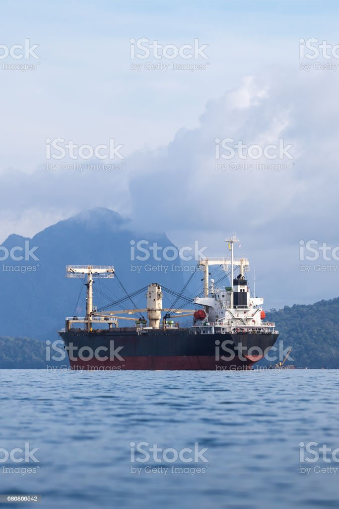 Large container cargo ship sailing in raining weather. stock photo