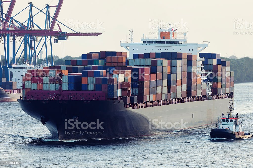 Large Container Ship Assisted By Tugboat in Hamburg Harbour royalty-free stock photo