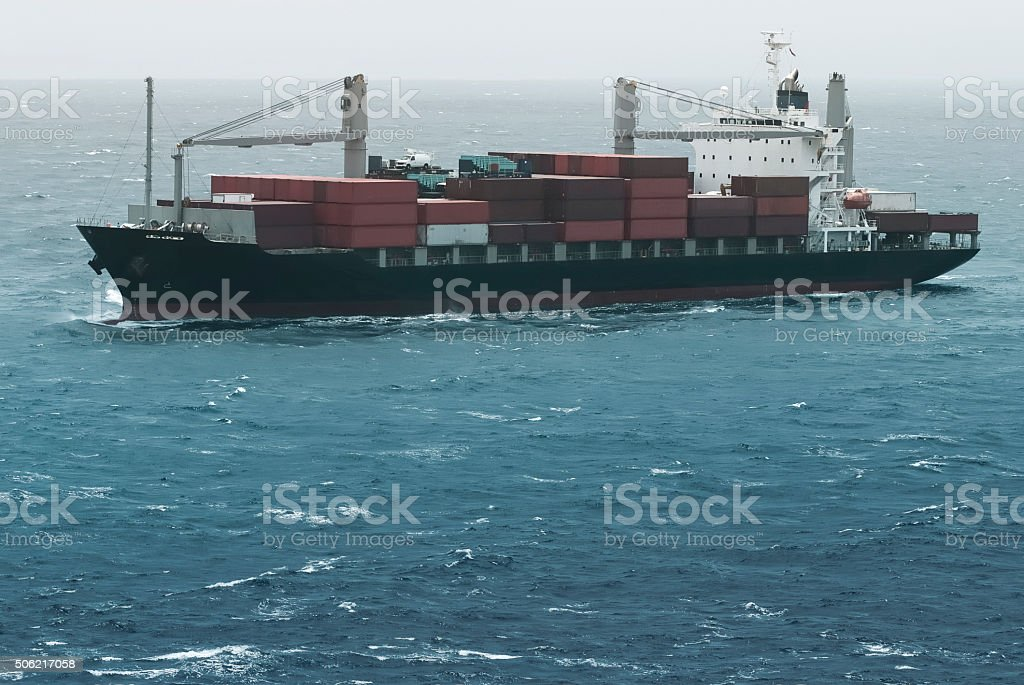 Large container ship in the open sea stock photo