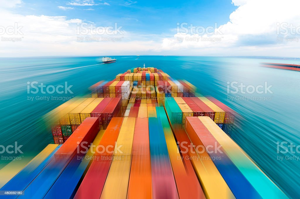 Large container vessel ship in motion stock photo