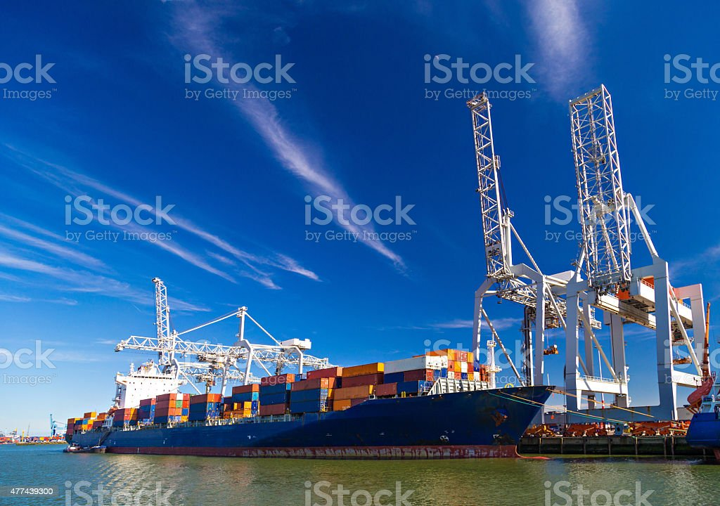 Large container vessel unloaded in Port of Rotterdam stock photo