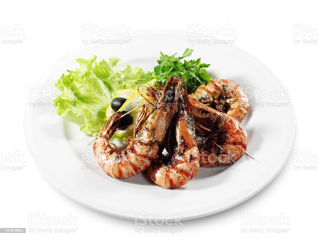 Large cooked prawns garnished with salad royalty-free stock photo