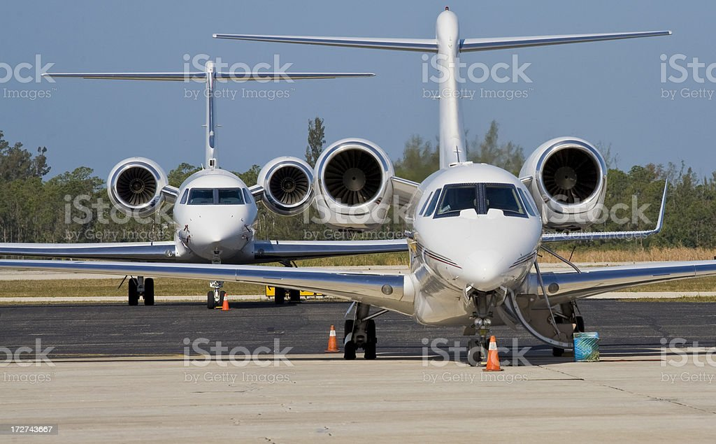 Large Corporate Jets Parked at Airport in Florida royalty-free stock photo