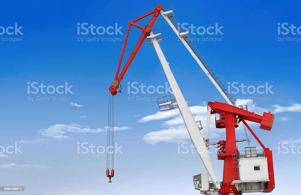 large crane on a background of blue sky and clouds stock photo