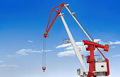 large crane on a background of blue sky and clouds